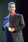 John DeNardo with SF SIgnal's Hugo Award; photo via Tor.com