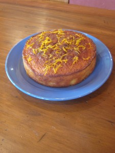 """An orange cake, on a blue plate ..."""